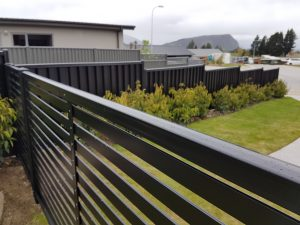 Colour slat and colour panel fencing by Wanaka Handyman